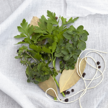 twine: Herbs and spices with twine and muslin, ready to make bouquet garni. Stock Photo