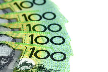 australian money: Australian one hundred dollar bills fanned over white background