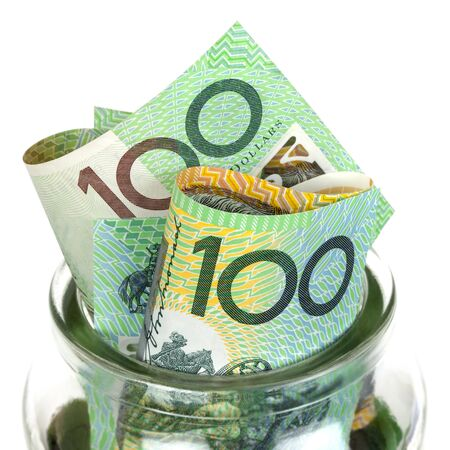 Australian money in jar, over white background   One hundred dollar bills  photo