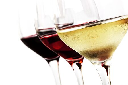 Three wine glasses over white background   White wine, rose, and red  photo