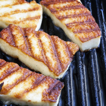 pan fried: Halloumi cheese frying in grill pan