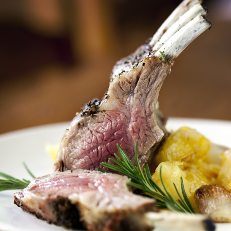 rack of lamb: Rack of lamb with rosemary and roasted potatoes    Stock Photo
