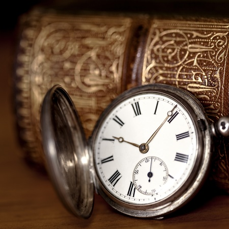 pocket book: Vintage pocket watch with old book