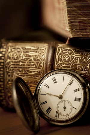 Vintage pocket watch with old books