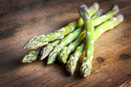 Asparagus on rustic timber   Fresh healthy eating  Stock Photo