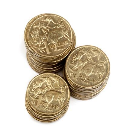 australian money: Stacks of Australian one dollar coins, isolated on white background. Stock Photo