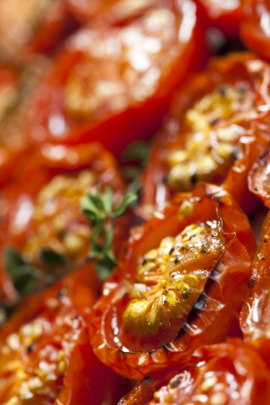 differential focus: Roasted cherry tomatoes with thyme.  Soft focus.