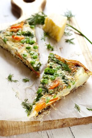 green pea: Delicious frittata with vegetables, topped with dill and parmesan.