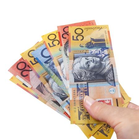 australian dollars: Handful of Australian money, isolated over white,