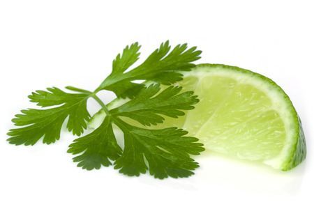 кинза: Lime and cilantro or coriander isolated on white.