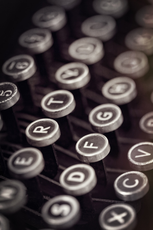 Closeup of vintage typewriter keys with grunge effects  photo