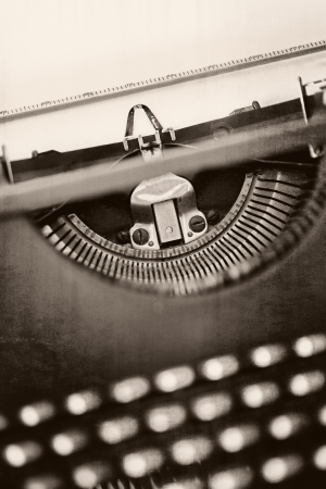 Vintage typewriter with grunge effects   Shallow depth of field, black and white tones  photo