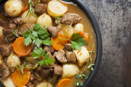 stew pot: Irish stew, made with lamb, stout, potatoes, carrots and herbs  Stock Photo