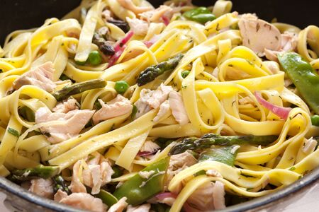 ribbon pasta: Pasta primavera with poached atlantic salmon.  Delicious, healthy eating.