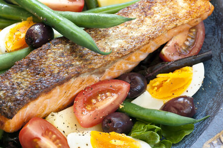 Salad nicoise with grilled atlantic salmon photo