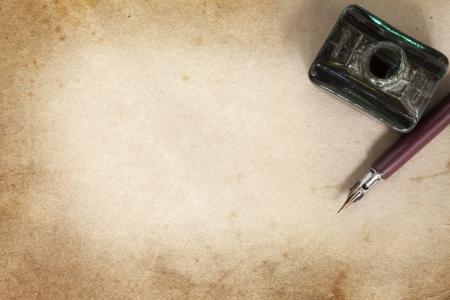 nib: Vintage nib pen and inwell, over grunge paper.