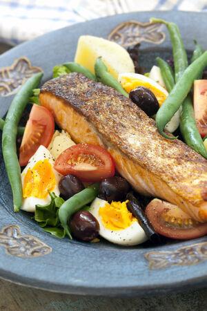 potato tuna: Salad nicoise with grilled atlantic salmon Stock Photo