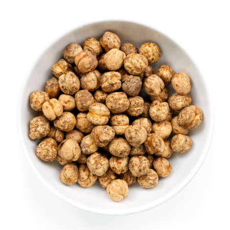 chickpeas: Roasted chickpeas in small bowl, isolated on white.  Delicious, healthy snacking.