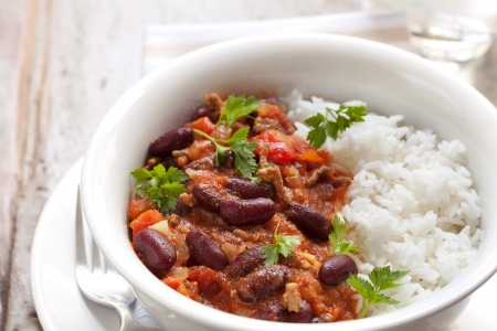 spicy chilli: Healthy chilli con carne with rice.   Stock Photo