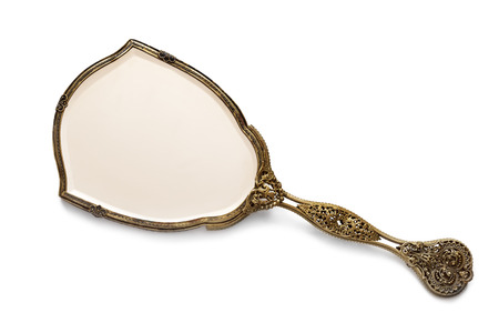 antique mirror: Vintage antique gilded hand mirror, isolated on white background.