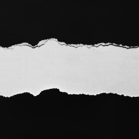 Torn black paper with space for copy. Stock Photo