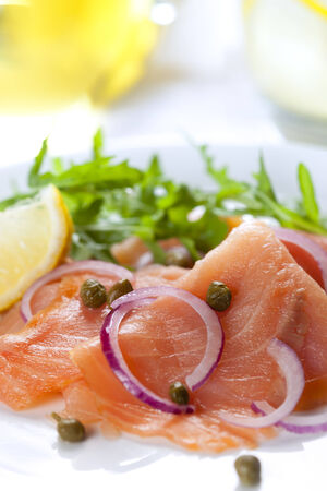 rocket lettuce: Smoked salmon salad with red onion, capers, lemon and arugula.