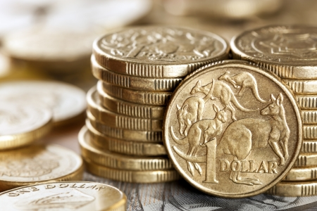 australian dollars: Stacks of Australian one dollar coins.  Focus on front coin. Stock Photo