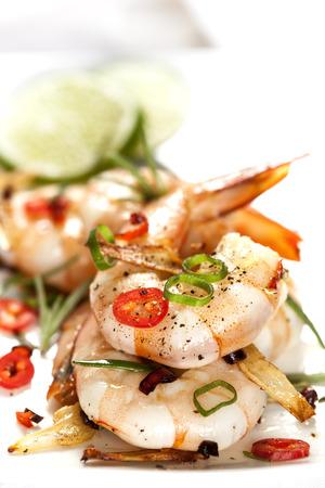 Garlic prawns garnished with red chili. photo