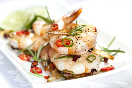Grilled shrimp with garlic, rosemary and chili. photo