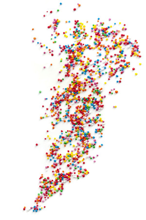 sprinkle: Colorful cake sprinkles scattered over white background.  Hundreds and Thousands.