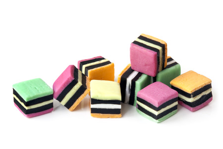 licorice: Liquorice allsorts over a white background.