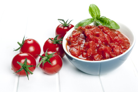 crushed by: Diced and whole tomatoes. garnished with basil.