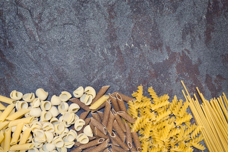 room for text: Pasta varieties over slate Stock Photo
