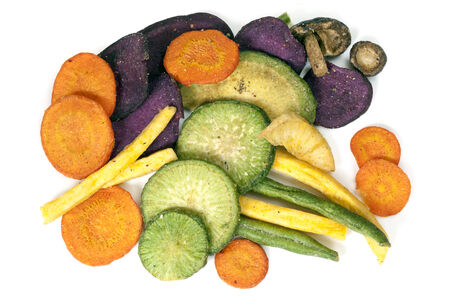 healthy snack: Vegetable crisps, isolated.  Healthy snack food. Stock Photo