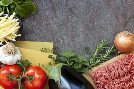 Ingredients for lasagna, over dark slate background. photo
