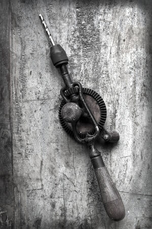 hand drill: Vintage hand drill over timber.  Grunge effects.