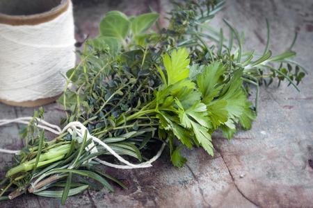 Bouquet garni of fresh herbs, tied with twine.  Rosemary, thyme, oregano, parsley.