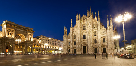 Milan Cathedral at night, panorama including Vittorio Emmanuele II gallery. Фото со стока