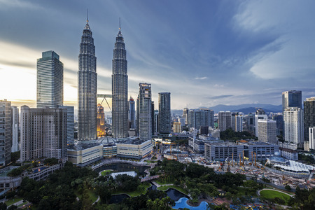 twin: Petronas Twin Towers and skyline, Kuala Lumpur.  Sunset view.