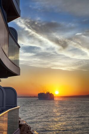 caribbean cruise: Cruise ship at sunset, viewed from another.  Glorious Mediterranean vacation.