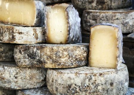 artisanal: French artisan cheese wheels.  Provence market.
