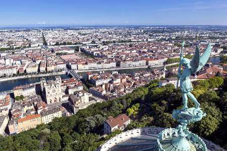 Lyon, France, viewed from the top of Notre Dame de Fourviere, with statue of St George. Mont Blanc is visible on horizon. photo