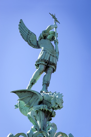 slaying: Statue of St George at top of Notre Dame de Fourviere in Lyon, France.