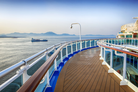 Deck of luxury cruise ship, overlooking islands in the Mediterranean. photo