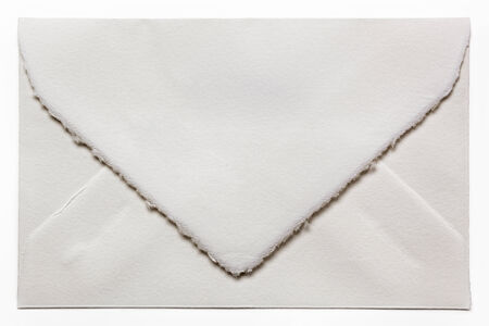 flap: Handmade white envelope isolated. Stock Photo