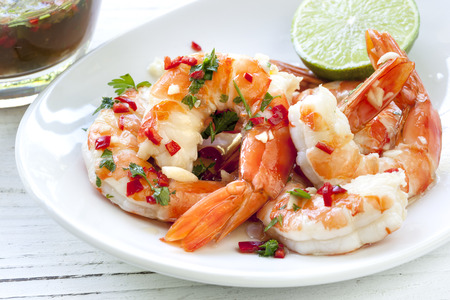 shrimp cocktail: Shrimp or prawns with chili and lime dipping sauce.