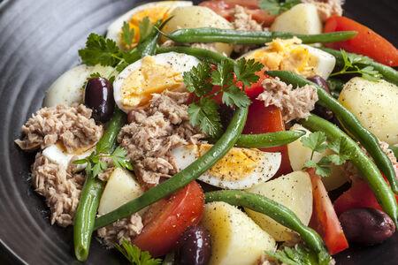potato tuna: Salad nicoise.  Tuna with baby potatoes, eggs, beans, tomatoes, olives and parsley.