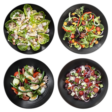 top down: Set of different salads on white background.  Includes chicken caesar, garden, nicoise, and Greek.