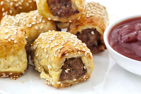 cooked sausage: Sausage rolls with tomato sauce or ketchup.  Puff pastry sprinkled with sesame seeds.