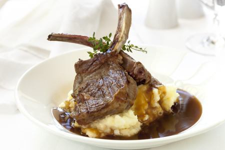 Lamb cutlets with mashed potato and gravy. Stock Photo